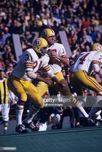 Quarterback Billy Kilmer of the Washington Redskins drops back to pass as runningback Charlie Harraway sets up to block during a game on November 14...