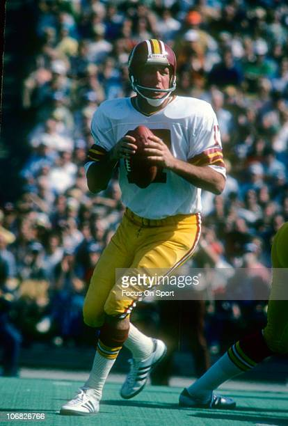 Quarterback Billy Kilmer of the Washington Redskins drops back to pass against the Chicago Bears during an NFL football game at Soldier Field October...