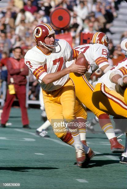 Quarterback Billy Kilmer of the Washington Redskins drops back to pass against the Philadelphia Eagles during an NFL football game at Veterans...
