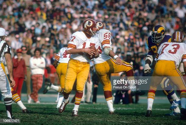 Quarterback Billy Kilmer of the Washington Redskins drops back to pass against the Los Angeles Rams during an NFL football game at the Los Angeles...