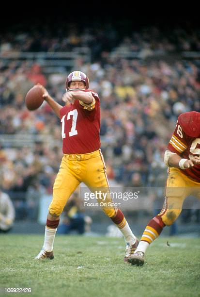 Quarterback Billy Kilmer of the Washington Redskins drops back to pass against the San Francisco 49ers during an NFL football game at RFK Stadium...