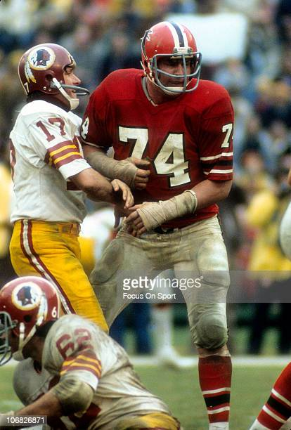 Quarterback Billy Kilmer of the Washington Redskins gets his pass off against the Atlanta Falcons during an NFL football game at AtlantaFulton County...