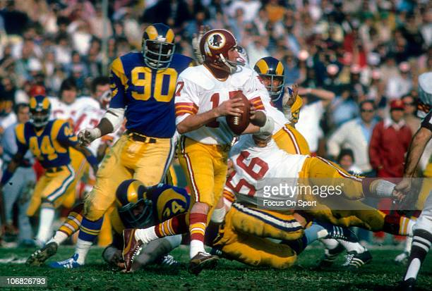 Quarterback Billy Kilmer of the Washington Redskins rolls out to pass against the Los Angeles Rams during an NFL football game at the Los Angeles...