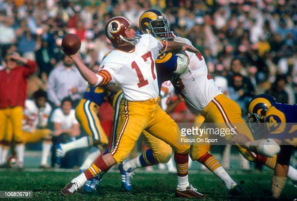 Quarterback Billy Kilmer of the Washington Redskins throws a pass against the Los Angeles Rams during an NFL football game at the Los Angeles...