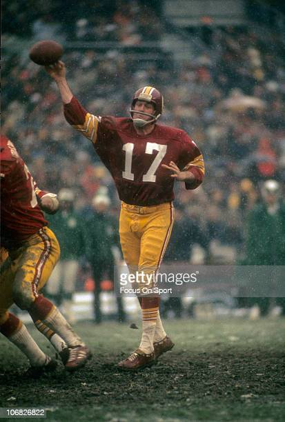 Quarterback Billy Kilmer of the Washington Redskins throws a pass against the Philadelphia Eagles during an NFL football game at RFK Stadium December...