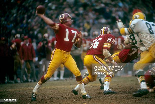 Quarterback Billy Kilmer of the Washington Redskins throws a pass against the Green Bay Packers during an NFL football game at RFK Stadium November...