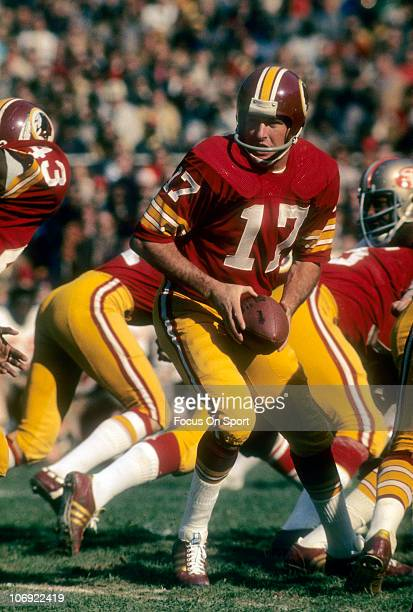 Quarterback Billy Kilmer of the Washington Redskins turns to hand off to Larry Brown against the San Francisco 49ers during an NFL football game at...