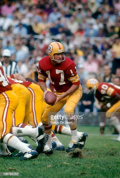 Quarterback Billy Kilmer of the Washington Redskins turns to hand the ball off to a running back during an NFL football game at RFK Stadium circa...