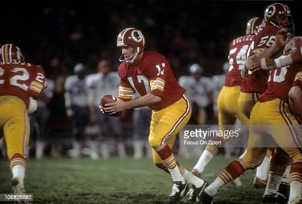 Quarterback Billy Kilmer of the Washington Redskins turns to hand the ball off against the Dallas Cowboys during an NFL football game at RFK Stadium...