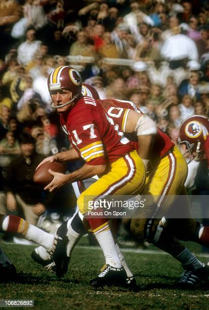 Quarterback Billy Kilmer of the Washington Redskins turns to hand the ball off to a running back against the New York Giants during an NFL football...