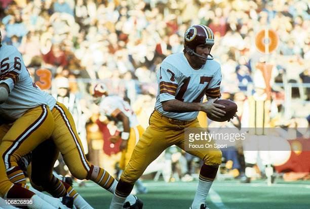 Quarterback Billy Kilmer of the Washington Redskins turns to hand the ball off to a running back against the Philadelphia Eagles during an NFL...