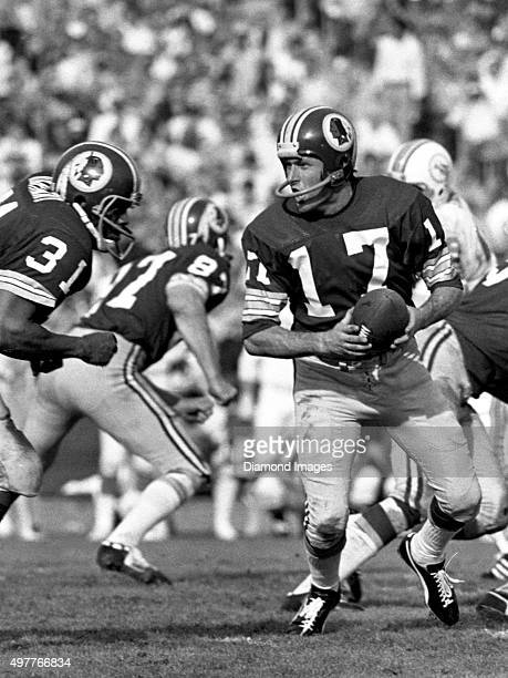 Quarterback Billy Kilmer of the Washington Redskins turns to hand the ball to the running back during Super Bowl VII on January 14 1973 against the...