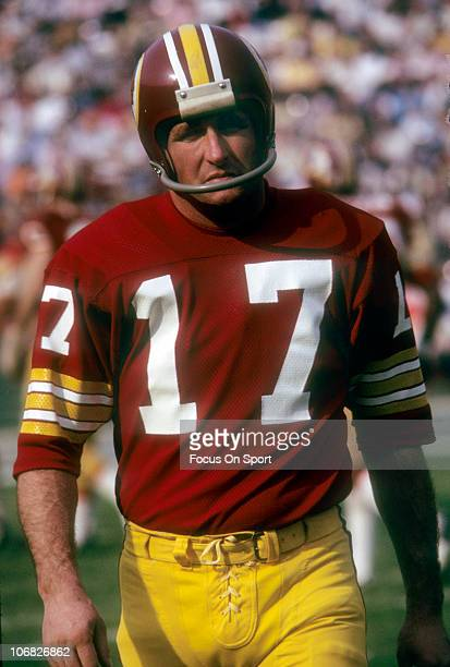 Quarterback Billy Kilmer of the Washington Redskins walks off the field during pregame warmups before an NFL football game at RFK Stadium circa 1973...