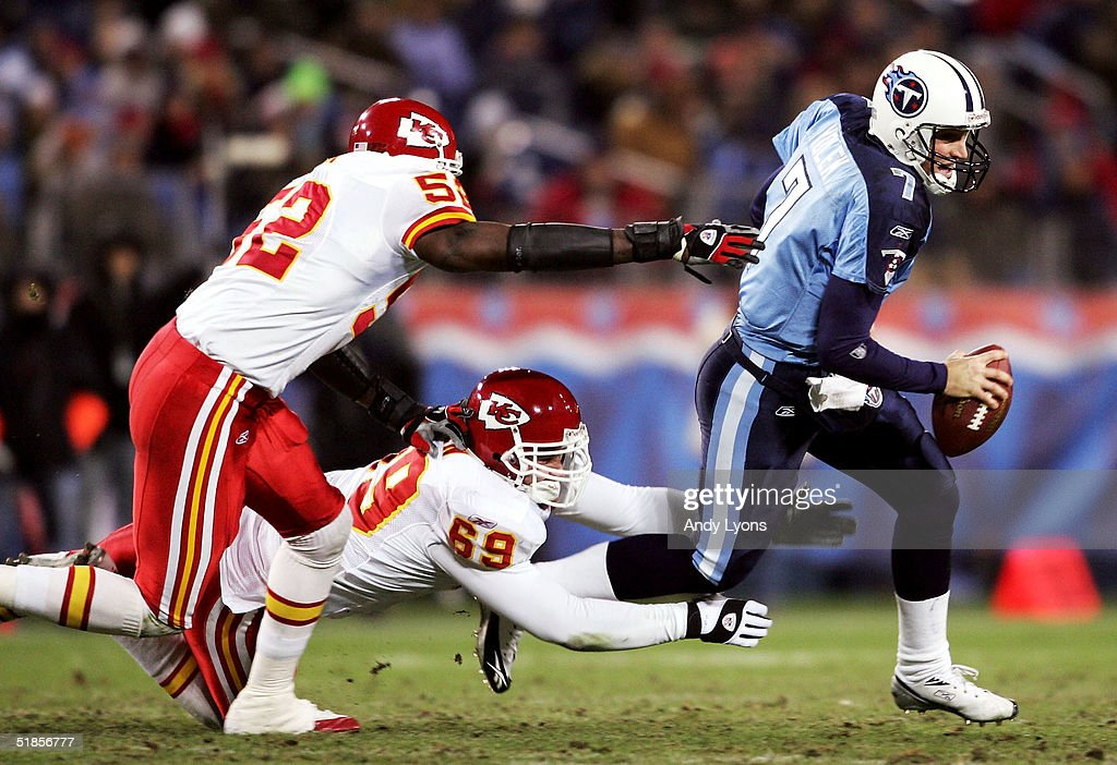 Quarterback Billy Volek #7 of the Tennessee Titans tries to avoid Quinton Carver #52 and Jared Allen #69 of the Kansas City Chiefs during Monday Night Football on December 13, 2004 at The Coliseum in Nashville, Tennessee.