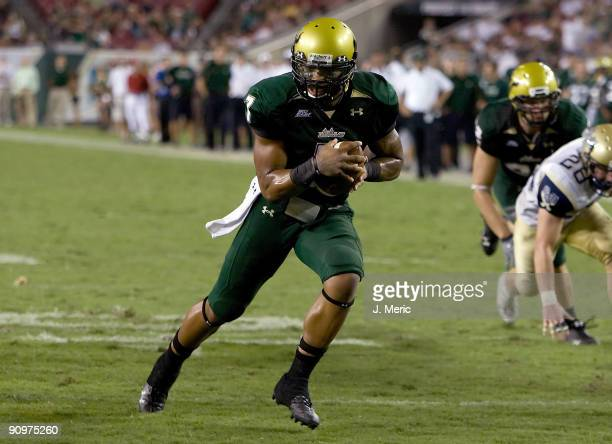 Quarterback BJ Daniels of the South Florida Bulls runs the ball for a touchdown against the Charleston Southern Buccaneers during the game at Raymond...