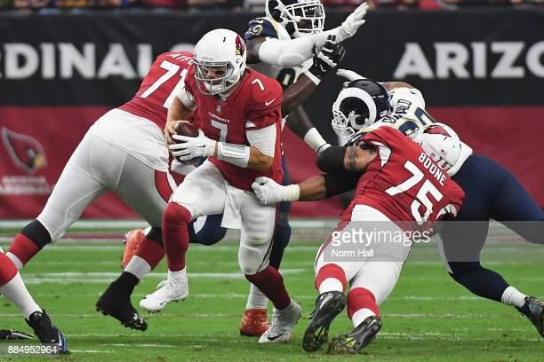 Quarterback Blaine Gabbert of the Arizona Cardinals runs past defensive end Aaron Donald of the Los Angeles Rams during the first half of the NFL...