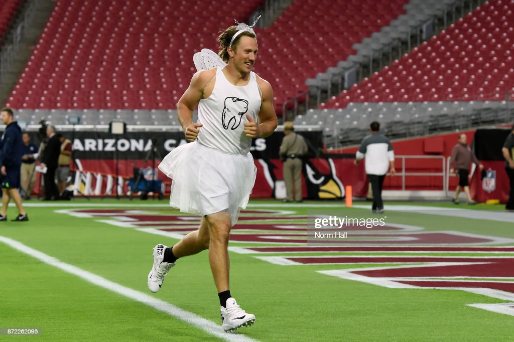 Quarterback Blaine Gabbert #7 of the Arizona Cardinals takes the field dressed in a tooth fairy costume prior to the NFL game against the Seattle Seahawks at University of Phoenix Stadium on November 9, 2017 in Glendale, Arizona. Gabbert had to wear the costume after losing a skills competition during practice the prior week.