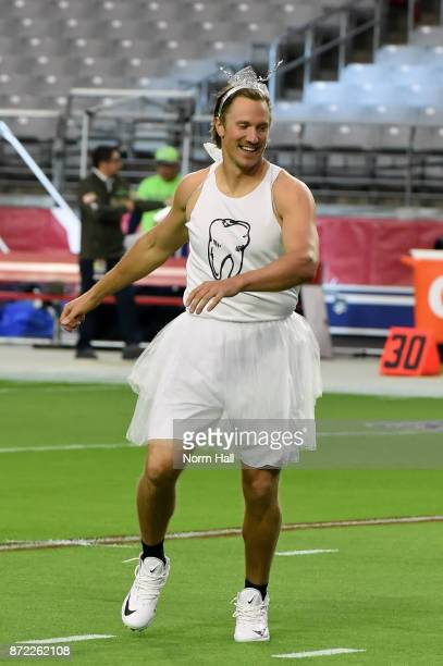 Quarterback Blaine Gabbert of the Arizona Cardinals takes the field dressed in a tooth fairy costume prior to the NFL game against the Seattle...