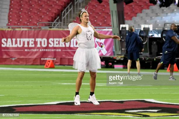 Quarterback Blaine Gabbert of the Arizona Cardinals warms up dressed in a tooth fairy costume prior to the NFL game against the Seattle Seahawks at...