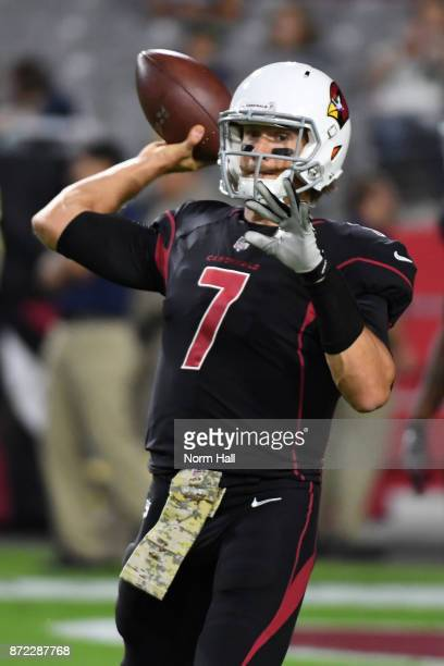 Quarterback Blaine Gabbert of the Arizona Cardinals warms up for the NFL game against the Seattle Seahawks at University of Phoenix Stadium on...