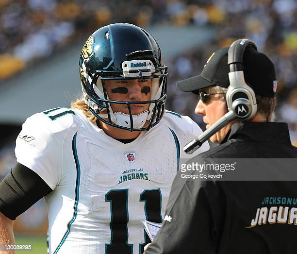 Quarterback Blaine Gabbert of the Jacksonville Jaguars talks with offensive coordinator Dirk Koetter on the sideline during a game against the...