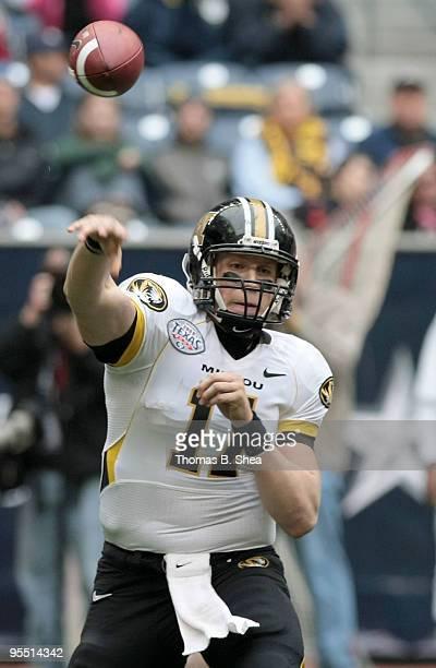 Quarterback Blaine Gabbert of the Missouri Tigers passes against the Navy Shipmen during the Texas Bowl at Reliant Stadium on December 31 2009 in...