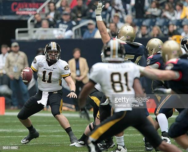Quarterback Blaine Gabbert of the Missouri Tigers scrambles against the Navy Shipmen after the Texas Bowl at Reliant Stadium on December 31 2009 in...