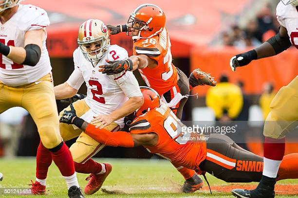 Quarterback Blaine Gabbert of the San Francisco 49ers is sacked by outside linebacker Armonty Bryant and free safety K'Waun Williams of the Cleveland...