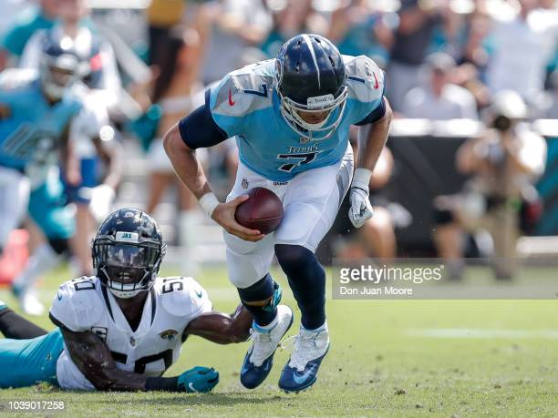 Quarterback Blaine Gabbert of the Tennessee Titans is tackled by Linebacker Telvin Smith of the Jacksonville Jaguars during the game at TIAA Bank...