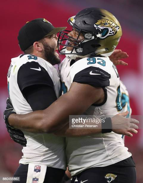 Quarterback Blake Bortles and defensive end Calais Campbell of the Jacksonville Jaguars celebrate after Campbell scored a touchdown against the...
