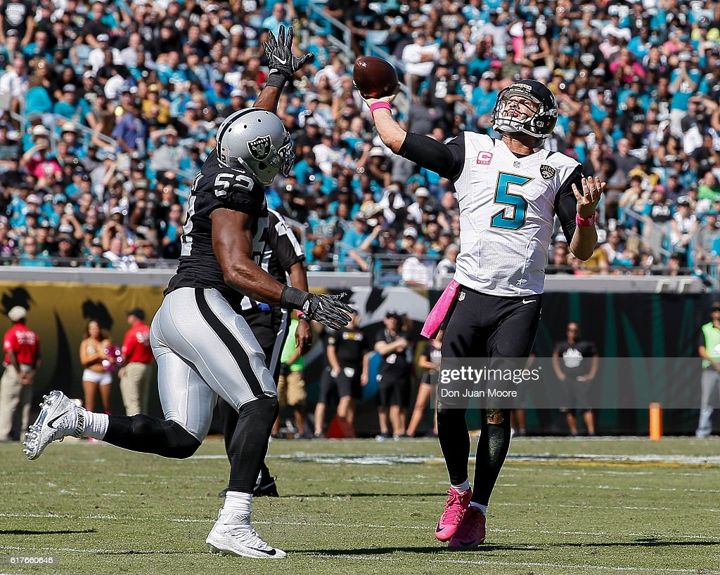 Quarterback Blake Bortles #5 of the Jacksonville Jaguars attempts to pass over Defensive End Khalil Mack #52 of the Oakland Raiders during the game at EverBank Field on October 23, 2016 in Jacksonville, Florida. The Raiders defeated the Jaguars 33 to 16.