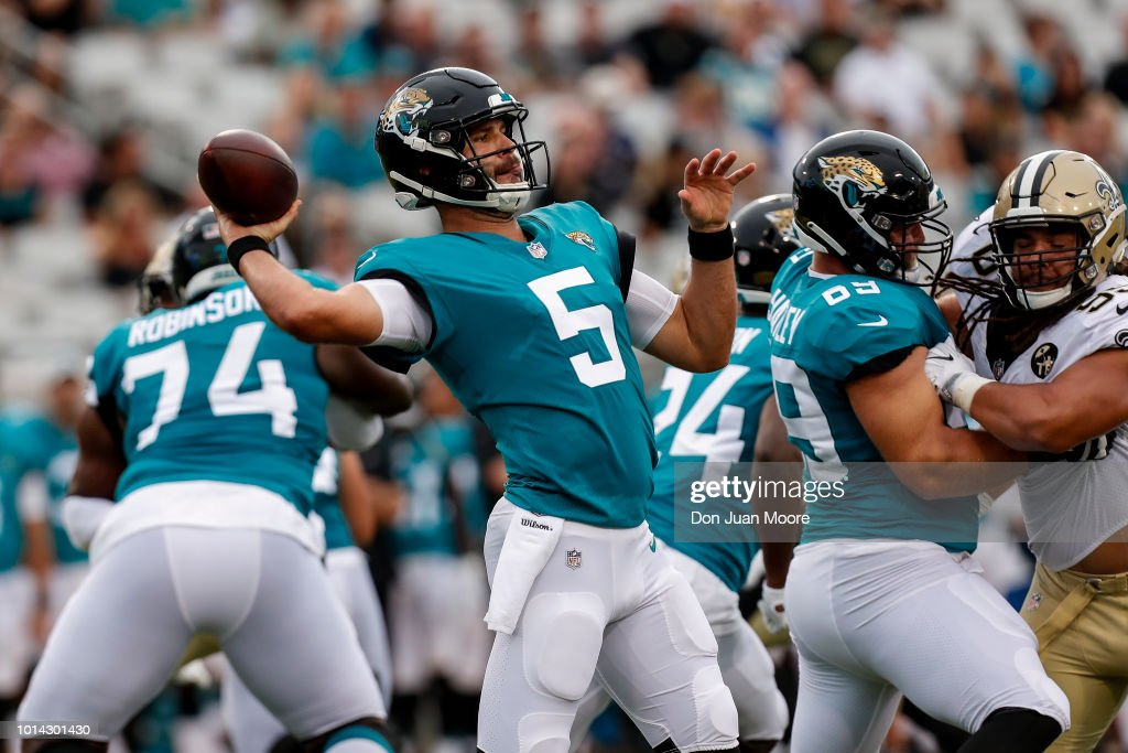 Quarterback Blake Bortles #5 of the Jacksonville Jaguars on a pass play during a preseason game against the New Orleans Saints at TIAA Bank Field on August 9, 2018 in Jacksonville, Florida. The Saints defeated the Jaguars 24 to 20.