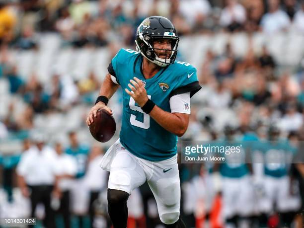 Quarterback Blake Bortles of the Jacksonville Jaguars runs for extra yards during a preseason game against the New Orleans Saints at TIAA Bank Field...