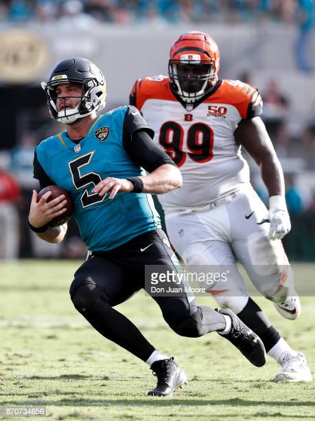 Quarterback Blake Bortles of the Jacksonville Jaguars slides to avoids a tackle by Defesive Tackle Andrew Billings of the Cincinnati Bengals during...