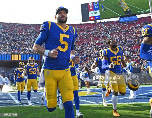 Quarterback Blake Bortles of the Los Angeles Rams runs on to the field for the game against the Arizona Cardinals at the Los Angeles Memorial...