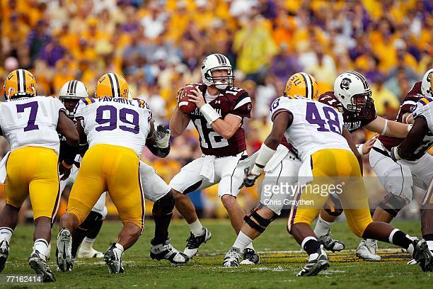Quarterback Blake Mitchell of the South Carolina Gamecocks throws under pressure from the Louisiana State University Tigers at Tiger Stadium...