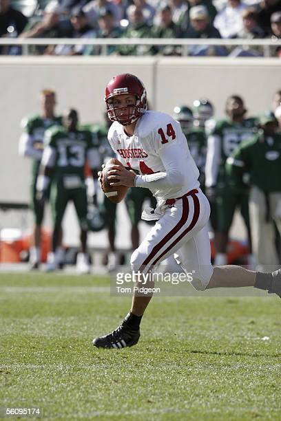 Quarterback Blake Powers of the Indiana Hoosiers rolls out against the Michigan State Spartans at Spartan Stadium on October 29, 2005 in East...