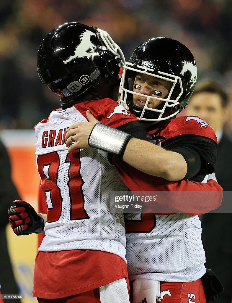 Quarterback Bo Levi Mitchell #19 of the Calgary Stampeders hugs teammate Bakari Grant #81 prior to the 104th Grey Cup Championship Game against the Ottawa Redblacks at BMO Field on November 27, 2016 in Toronto, Canada.