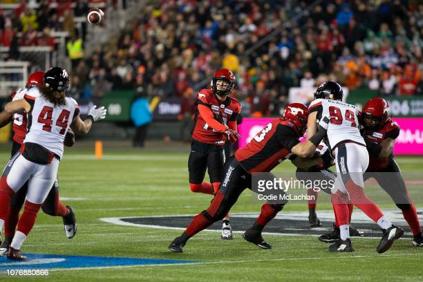 Quarterback Bo Levi Mitchell of the Calgary Stampeders throws a pass against the Ottawa Redblacks during the Grey Cup at Commonwealth Stadium on...