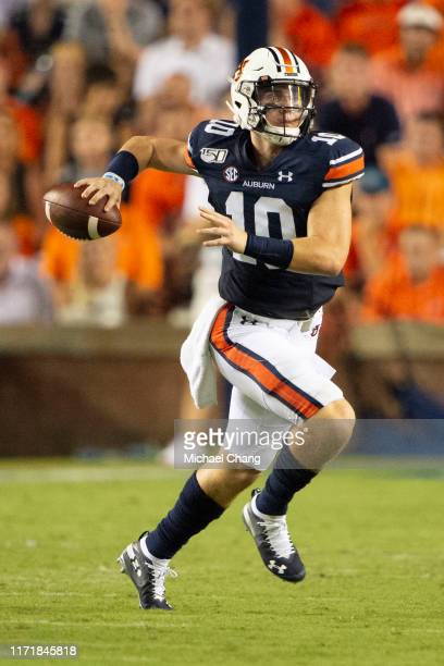 Quarterback Bo Nix of the Auburn Tigers looks to throw a pass during the second quarter of their game against the Mississippi State Bulldogs at...