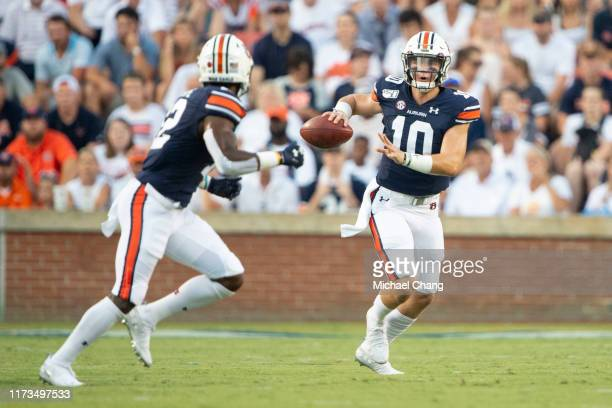 Quarterback Bo Nix of the Auburn Tigers looks to throw a pass to wide receiver Eli Stove of the Auburn Tigers during their game against the Tulane...
