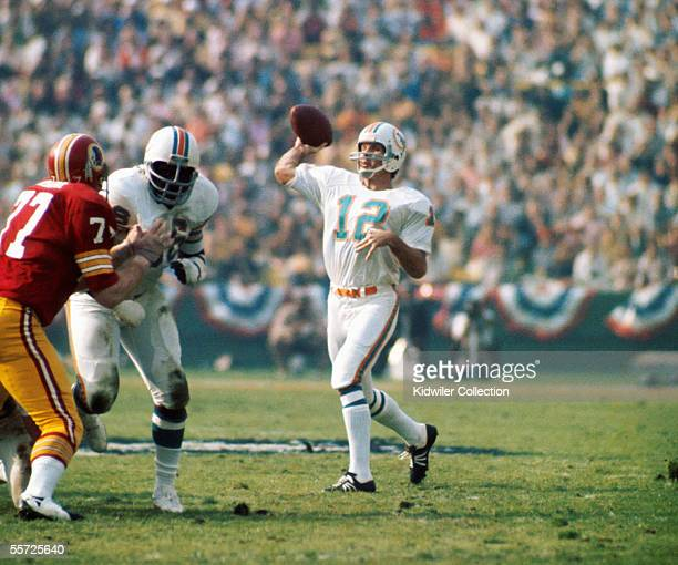 Quarterback Bob Griese of the Miami Dolphins throws a pass during Super Bowl VII on January 14 1973 against the Washington Redskins at the Coliseum...