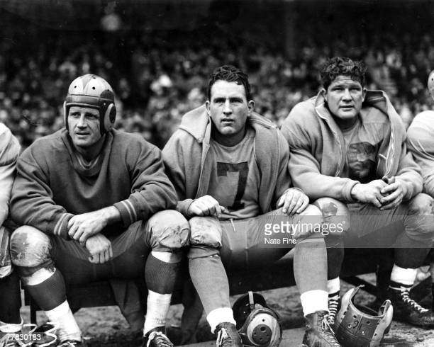 Quarterback Bob Waterfield of the Los Angeles Rams looks on from the bench in a 1948 game