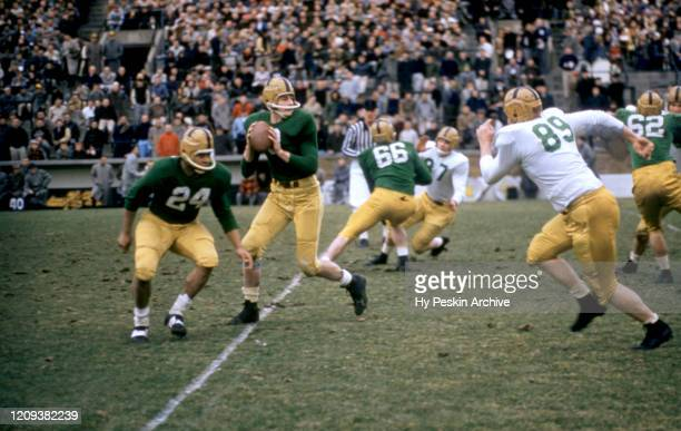 Quarterback Bob Williams of the Notre Dame varsity team drops back to pass during an alumni game against the Notre Dame alumni team on April 16, 1957...