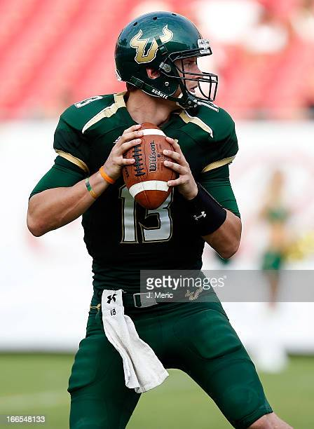 Quarterback Bobby Eveld of the green team of the South Florida Bulls throws a pass during the annual Spring Game at Raymond James Stadium on April 13...