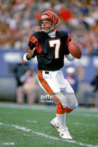 Quarterback Boomer Esiason of the Cincinnati Bengals drops back to pass against the Cleveland Browns at Municipal Stadium on October 30 1988 in...