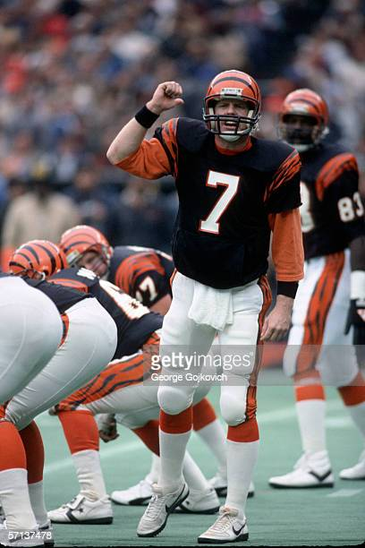 Quarterback Boomer Esiason of the Cincinnati Bengals signals before the start of a play during a game against the Dallas Cowboys at Riverfront...