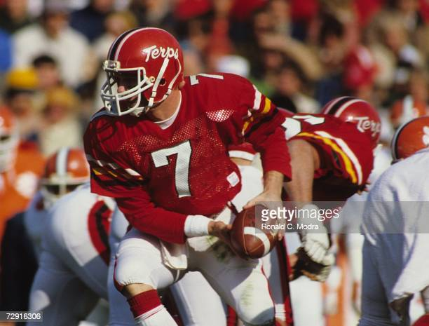 Quarterback Boomer Esiason of the University of Maryland Terrapins during a game against the Clemson Tigers on November 13 1982 in College Park...