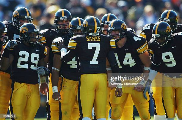 Quarterback Brad Banks of the Iowa Hawkeyes leads the offensive huddle during the Big 10 Conference football game at Kinnick Stadium against the...