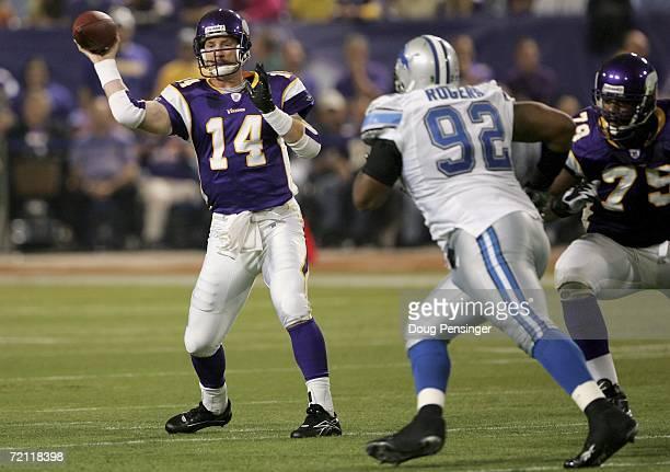 Quarterback Brad Johnson of the Minnesota Vikings passes against Shaun Rogers of the Detroit Lions October 8 2006 at the Metrodome in Minneapolis...